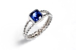 Engagement Ring: 14K white gold with sapphire