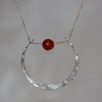 Our all-time favorite Luna necklace with a carnelian bead. Available on rebeccazemans.com !